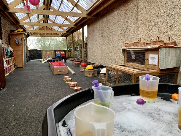 Covered outdoor learning and play area at High Bank